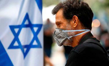 كورونا  الاحتلال  إسرائيل  إصابات  كمامة  وباء- جيتي